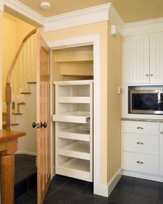 Kitchen Pantry Built In Under The Stair, With With Pullout Shelves. Kitchen