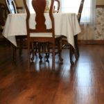 Wood look luxury vinyl plank (LVP) by Karndean installed in dining room