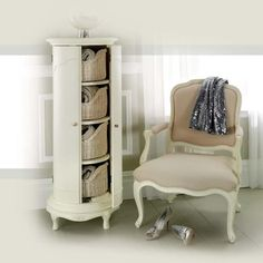 Another example of our beautiful Ivory Inspired Storage Cabinet and Upholstered Armchair.