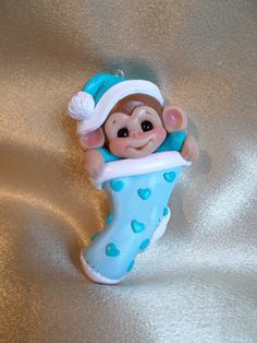 Baby Baby's first Christmas Stocking Ornament monkey animal children blue Personalized Polymer Clay Baby Gift. $15.95, via Etsy.