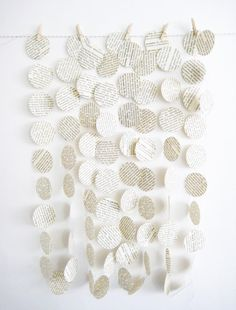 I made garland like this using pages from old Jane Austen paperbacks ... I think I am the only one who knew but I liked the idea of tying in a romance story with a wedding...