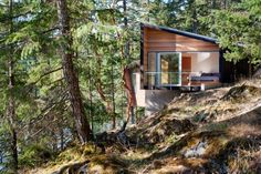 Vacation house on a steep, remote site overlooking British Columbia's Center Bay. By BattersbyHowat architects