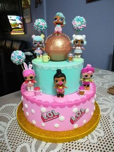 Two-tiered round cake decorated in pastel colors with LOL Surp figures Doll Birthday Cake, Funny Birthday Cakes, Barbie Birthday, Bolo Fack, 7th Birthday Party Ideas, 5th Birthday, Surprise Cake, Surprise Birthday, Lol Doll Cake