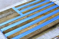 pallet wood painted with american flag | Use a small roller to apply the red paint, remember, it doesn't have ...