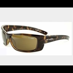 Arnette Slammer Sunglasses Style 4115 Unisex Dark leopard with Brown ...used a couple times, in great condition! Simple and sporty, the Slammer from Arnette has a lightweight, yet durable grilamid frame with an extended design for fuller coverage, sleek and comfortable, logo stamped ear pieces, and 100% UV protected lenses. Arnette has established itself as a leader in youth-inspired, lifestyle eyewear market and is backed by some of the best action sports athletes Ray-Ban Accessories…