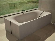 Concrete Tub that splits in the middle – Wave by DadeDesign  This amazing bathtub is a great solution that can fit into any interior. The tub has a special split in the middle, thanks to which it can be easily transported in two halves and mounted together on-site. A perfect harmony of shape, feel and flexibility.