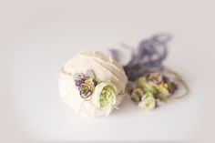 Beautiful handcrafted newborn floral crown with adjustable ties.