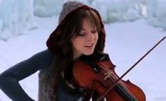 """Title: Mormon Violinist Lindsey Stirling: Remaining True to Self. """"Lindsey Stirling, a member of The Church of Jesus Christ of Latter-day Saints (comminly referred to as the Mormon church), was born in Orange County, California on 21 September 1986, but grew up in Gilbert, Arizona. She is an American violinist, musician, dancer, performance artist, and composer. She presents choreographed violin performances, both live and in music videos, including on her YouTube channel."""""""