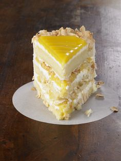 "Recipe For Lemon Coconut Cake - This classic layer cake features a tangy lemon filling between layers of tender white cake and a rich coconut-cream cheese frosting. Online reviewers proclaim the cake ""divine"" and ""one of the best cakes they've ever eaten."""