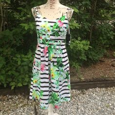Fantastic summer dress! This beauty is so pretty with its classic black and white stripes but it has flair because of the green and pink flower print. It has a side zip and an opening in the back. It is perfect for vacation or just staying home and going to the local coffee shop. R&K Dresses