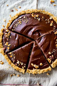 The most unbelievably rich and creamy Nutella Tart! Complete with a toasted hazelnut crust. Recipe on sallysbakingaddiction.com