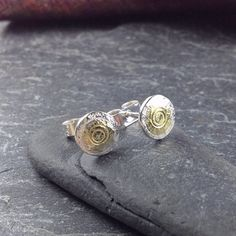 small silver and gold round Boss stud earrings £42.00