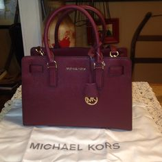 """❄️HOLIDAY SALE❄️ NWT Michael Kors """"Dillon"""" Satchel This % authentic Michael Kors bag is so beautiful!!!!! The color is Merlot.  All the hardware is gold. It comes with original stuffing, dust bag and detachable adjustable shoulder strap. Trades Michael Kors Bags Satchels"""