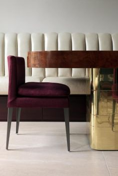 Furniture - wonderful layering....white tucked leather banquette, jewel tone aubergine velvet side chair & round wood top with shiny brass base pedestal table.....love all three