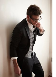 This is a great outfit! It's casual yet dressy. Everything from the sleeves to the vest colour, jacket, pants and I love the glasses with the outfit. Great look.