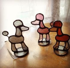 Stained glass poodles