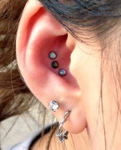 Dual Lobe And Tripple Conch Ear Piercings