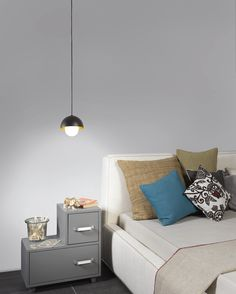 A functional and comfortable interior setting emerges wherever the Boleta mini pendant light by Zaneen is present. its sleek contemporary design is characterized by a blend of half spheres, with one crafted from blown glass and the other from meta. Furniture, Light Colors, Interior, Small Pendant Lights, Interior Deluxe, Warm White, Contemporary Design, Gold Interior, Light