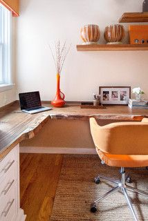 close-up on the live wood edge.   desk made of reclaimed indonesian teak.   the office pops thanks to mod orange chairs and other orange accents.  Interior design by Amy Cuker, down2earthdesign.com