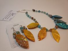 Check out this item in my Etsy shop https://www.etsy.com/listing/191502887/beaded-yellow-gold-and-blue-leaf