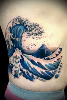 Inspiration for splashing ocean waves within heart tattoo design