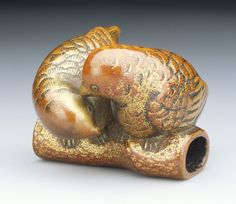 Lovebirds netsuke. Alternate Title: 牡丹鸚哥. Japan, 19th century. Red and gold lacquer