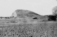 Archaeologists destroying one of the Cahokia Mounds