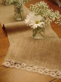 burlap and lace table runner. very cute for a country theme! love the simplicity of the flowers