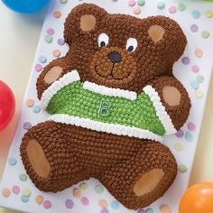 Everyone loves a teddy bear! Who can resist this sweet little guy all dressed up in his party best? Wearing a dapper little sweater than can be personalized with the initials of the guest of honor. Baby Shower For Men, Baby Shower Niño, Baby Shower Cakes, Birthday Party Snacks, Baby Birthday Cakes, Boy Birthday Parties, 2nd Birthday, Teddy Bear Cakes, Wilton Cake Decorating