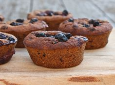 Blueberry, Banana and Raisin Muffins (Makes 15 muffins)  - 2 cups blueberries - 4 over-ripe bananas - 1 cup oats - 1 cup almonds - 1 cup ground flaxseed - 1 cup raisins - 3/4 cup apple juice - 1/2 cup water - 4 tbsp date syrup - 4 tbsp pure maple syrup - 2 tsp cinnamon