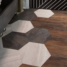 Custom Hexagon Floor  While looking high-end and expensive, this dramatic flooring was created using simple peel and stick flooring from Lowe's. A combination of different color 18x18 tiles were cut into hexagons and used to make a unique pattern adding visual interest to the whole space.