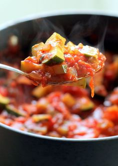 Making your own tomato sauce is entirely easy and completely worth it! This sauce is delicious with the addition of fresh tomatoes, garlic, basil, red pepper flakes, and zucchini.