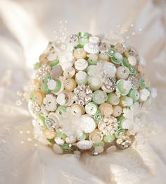 Downton Button Bouquet in ivory, cream and mint green with pearl and fabric flower highlights. £290.00, via Etsy.