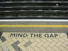 """Mind the Gap"" was introduced on the Tube in 1969. Currently the message ""Please mind the gap between the train and the platform."" is piped into the arriving train carriages, but it used to be broadcast over the station PA repetitively, in BBC-style received pronunciation. ""Mind the ge-yap!"" Much to the delight of visiting tourists. It was actually the sound engineer's voice, as the actor originally cast wanted royalties. Bank station on the Central Line is one place where it can be heard."