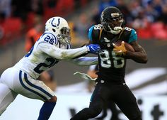 LONDON, ENGLAND - OCTOBER 02: Allen Hurns of Jacksonville fends off the tackle from Patrick Robinson of Indianapolis during the NFL International Series match between Indianapolis Colts and Jacksonville Jaguars at Wembley Stadium on October 2, 2016 in London, England.  (3000×2149)
