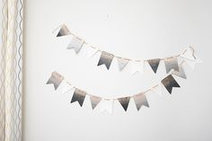 Sombre pennant banner with #DecoArt wood stain and #Darice wood pennant pieces