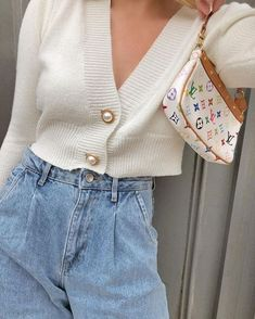 Wide-sleeved Gal White Cropped Cardigan features a cropped length, heavy rib-knit fabric in white, oversize button closure and a V-neck collar. Keep yourself out of the cold with the Gal White Cropped Cardigan.