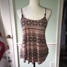 Forever 21 tribal tank Pink and black tribal patterned tank top with braided straps and beads. Size medium, soft and stretchy. My closet is having a buy two get one free sale, please ask for details! Forever 21 Tops Tank Tops