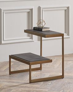 """Modern tiered end table. 24""""W x 22""""D x 25.25""""T. Brass frame; two hardwood shelves. Imported. Boxed weight, approximately 55 lbs."""