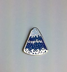 Get ready to explore with this beautiful mountain enamel pin! Wear it wherever your adventures take you..... Pin Type: Hard Enamel. Pin has been polished and is smooth! Metal color: High polished Gold Enamel color: Navy blue & white Size: 1 inch Backing: Metal clasp This listing is for 1 pin follow on Instagram @fernandpineco