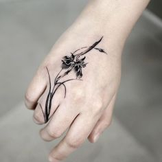 Flower on the wrist tattoo Iris Flowers, Love Flowers, Flower Tattoo Designs, Flower Tattoos, Blackwork, Iris Tattoo, Korean Tattoos, Black Iris, Semi Permanent Tattoo