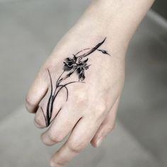 Flower on the wrist tattoo Flower Tattoo Hand, Flower Tattoo Designs, Flower Tattoos, Iris Flowers, Love Flowers, Blackwork, Iris Tattoo, Korean Tattoos, Black Iris