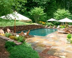 very pretty...colors of stone, pool colors, retaining wall, foliage. Simple design but lovely