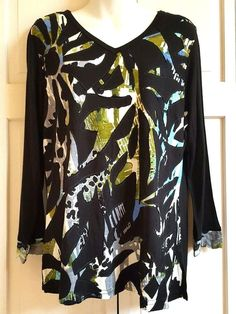 Parsley & Sage woman's long sleeve knit tunic top. Size Medium. Parsley & Sage garments are individually tailored, not mass produced. Each is an elegant work of art. Front has black applique. Body is black, green, aqua and white abstract print and sleeves are black with print bands at hem. | eBay!
