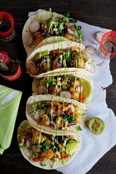 Vegan Masala Cauliflower And Broccoli Tacos With Avocado-Coriander Sauce, Pineapple Chutney And Radish-Red Onion Salad.