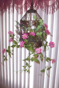 Bird cage full of flowers for Flower girl to carry. Description from uk.pinterest.com. I searched for this on bing.com/images