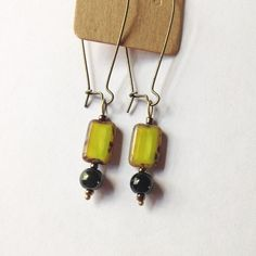 Handmade Green & Bronze Drop Earnings Handmade by me! Bright and dark green glass beads on a hypoallergenic bronze drop earring post. Comes in a cute package, perfect for gifting! lilac & buttercup Jewelry Earrings