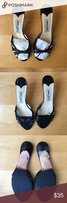 JIMMY CHOO black leather Mules sandal bow 37.5 7.5 Black leather Mules, open toe sandals. Black leather bow, in original box. Heel-2.5 inches. New leather soles. Some scratches, see photos. Jimmy Choo Shoes Sandals
