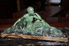 "Beautiful French Art Deco Heavy Patinated Metal Sculpture of Lady with Panthers. Signed ""Godard"" on Porto Marble and Onyx Base, Verde Patina."
