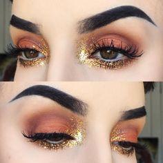 warm orange eye w/ gold glitter inner-corner highlight extending upwards & into the whole lower lashline @kayteeellen | grunge-y glam makeup, no liner